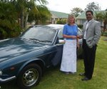 Suzanne Bundy gives Errol Naidoo a gift of a car