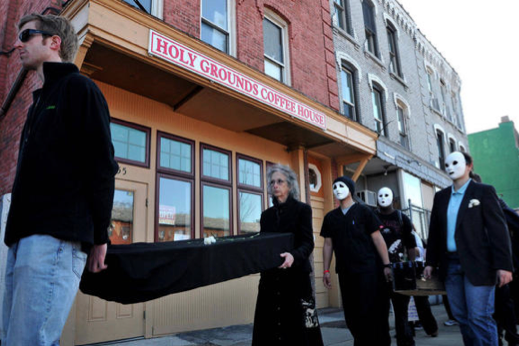 Coffins Outside Scott Lively's coffee shop Where Preaching of Hate is a daily tool