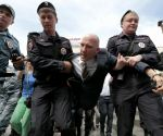 Police detain Russia's leading gay rights campaigner Yuri Gavrikov during an unsanctioned gay rally near the City Hall in Moscow, Saturday, May 25, 2013.