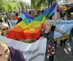 Gay rights activists take part in a march across Kiev May 25, 2013. REUTERS/Gleb Garanich