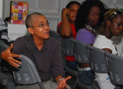 Karen De Souza, National Coordinator of Red Thread, makes a point at a debriefing meeting at Moray House Trust with SASOD and Guyana Trans United immediately following the court hearing on Tuesday. Courtesy SASOD.