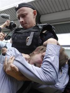 "A policeman detains a gay rights activist during a protest against a proposed new law termed by the State Duma as ""against advocating the rejection of traditional family values"" in central Moscow"