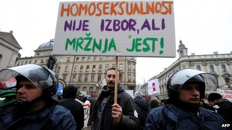 """A protester's sign reads """"Homosexuality is not a choice, hate is a choice"""" Photo courtesy BBC"""