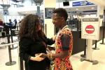 Melanie Nathan Meets Ham Darly on his arrival as refugee from Uganda at Oakland International Airport . Photo: SFALI.org