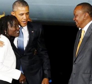 President Obama arrives in kenya - seen with PM and his sister Aumo