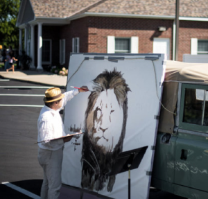 Mural of Cecil Lion being painted outside Palmer dental office