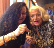 Melanie Nathan giving a Nelson Mandela coin to Edie Windsor.